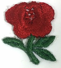 Photo of an embroidered red rose lapel sticker