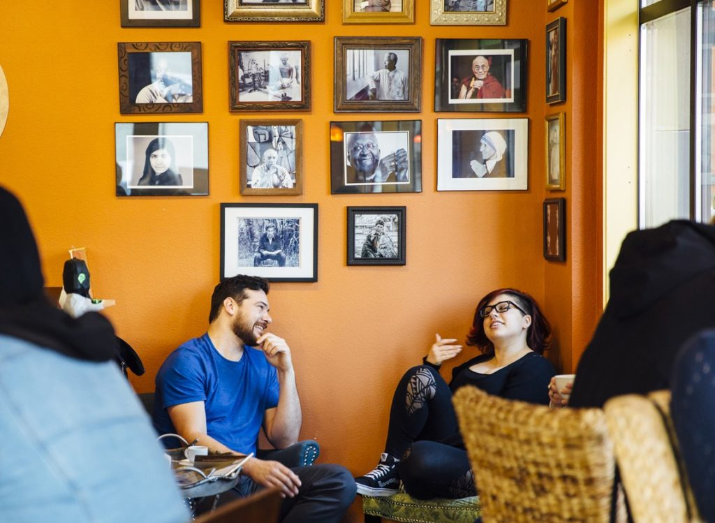 Customers lounge inside Revolución Coffee House.