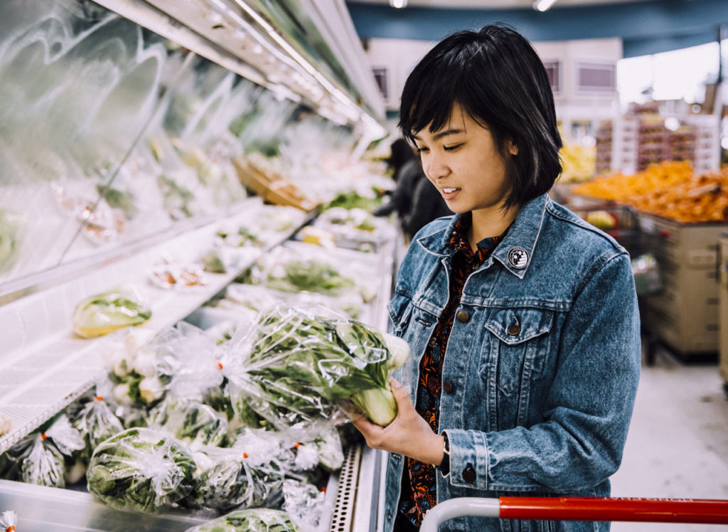 Woman shops for produce at Asian grocery store Hong Phat.