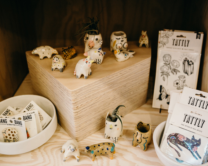 a display of small ceramic animals and hand made cards