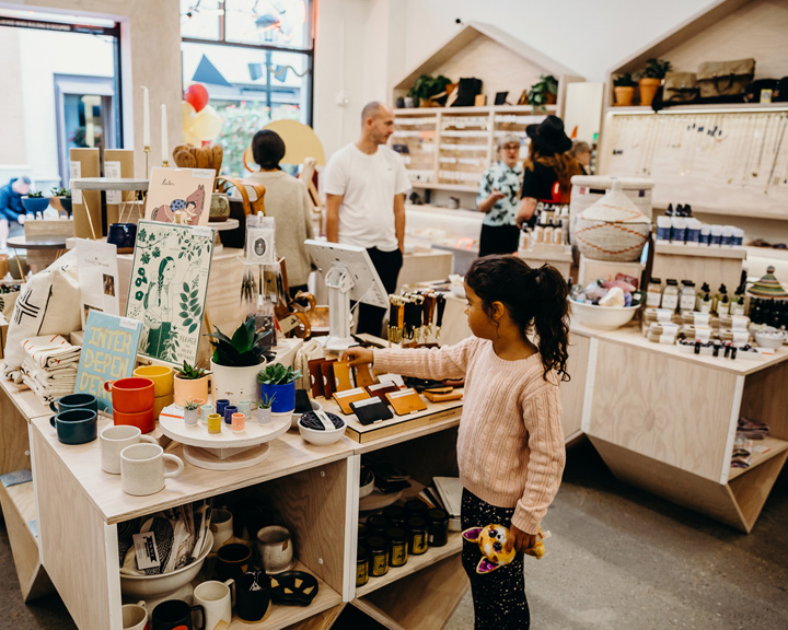 people shopping in a store full of interesting knick knacks