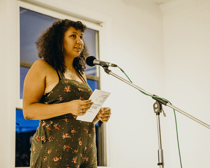 Woman speaking into microphone at Future Prairie Collective